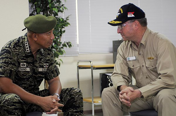 Armed Forces of the Philippines (AFP) Chief of Staff Gen. Alexander B. Yano and Rear Adm. James P. Wisecup, commander, Carrier Strike Group (CSG) 7, discuss the progress and plans for future clean up efforts of the Philippines.