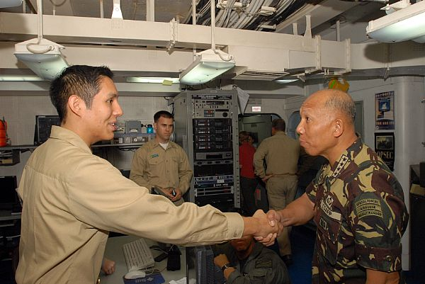 Armed Forces of the Philippines, Chief of Staff, Gen. Alexander B. Yano shares a handshake with Lt.j.g. Eduardo Vargas