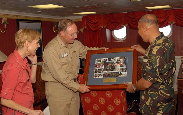 Armed Forces of the Philippines, Chief of Staff, General Alexander B. Yano of the Philippines Army presented with a collection of photos depicting relief efforts by USS Ronald Reagan (CVN 76), and other ships in her group