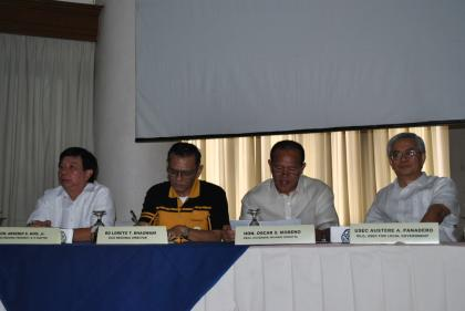 From left Liga ng mga Barangay Regional President Arsenio Kho, DILG-10 Regional Director Loreto Bhagwani, Misamis Oriental Governor Oscar Moreno, and DILG Undersecretary for Local Government Austere Panadero sit comfortably at the presidential table before the start of program. (DILG)
