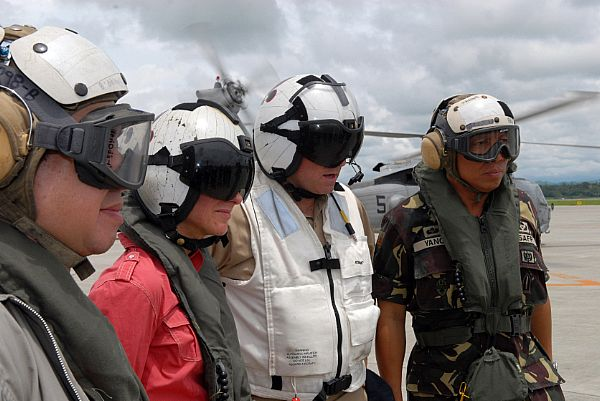 From right to left, Armed Forces of the Philippines Chief of Staff, General Alexander B. Yano, Commander Carrier Strike Group Seven, Rear Adm. James P. Wisecup, U.S. Ambassador to the Philippines, Kristie A. Kenney and Republic of the Philippines Senator Dick Gordon prepare to take a helicopter ride to survey the island and drop off supplies. American and Philippine officials, met at Iloilo Airport to share their goals and show their support for Typhoon Fengshen relief efforts.