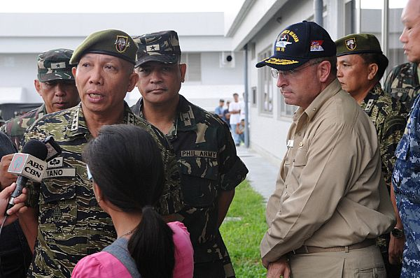 Gen. Alexander B. Yano, chief of staff, Armed Forces of the Philippines (AFP), discusses relief efforts with local media