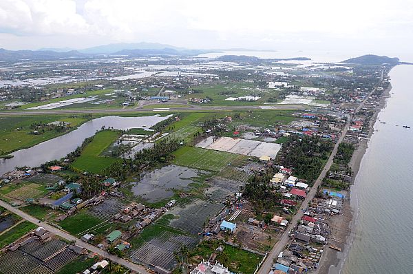 High above Roxas, standing water is visible after the wake of Typhoon Fengshen. The northern part of the island was heaviest hit by the typhoon.