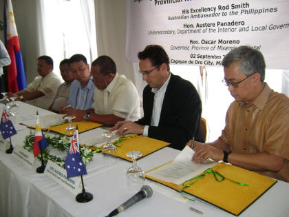 MOA SIGNING: Australian Ambassador to the Philippines Rod Smith, Misamis Oriental Governor Oscar S. Moreno and DILG-10 Regional Director Austere Panadero ink a Memorandum of Arrangement covering the implementation of the Provincial Road Management Facility that would entitle the province of a P40 million grant from the Australian government intended to improve and maintain its roads in the hinterland barangays. The signing ceremony was also witnessed by local officials including Vice Gov. Norris Babiera, Opol Mayor Dixon Yasay and Claveria Mayor Redentor Salvaleon. (Misamis Oriental Provincial Press Office)