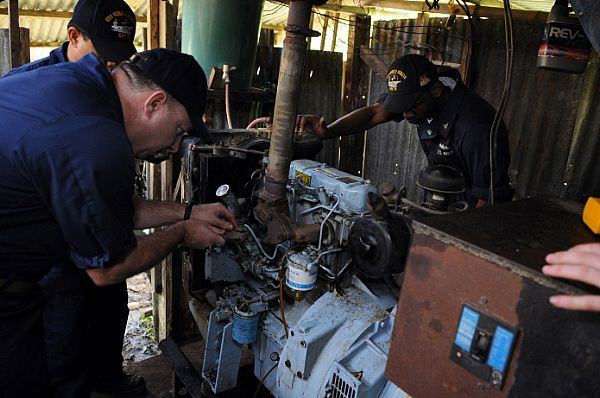 Master Chief Engineman Joseph Matteo troubleshoots a fuel pump on a generator at Barotac Viejo Regional Hospital in Iloilo. Matteo and other Sailors assigned to the Engineering Department aboard the Nimitz-class aircraft carrier USS Ronald Reagan (CVN 76) have been inspecting, troubleshooting and repairing generators at hospitals in need of clean water and electricity after Typhoon Fengshen.