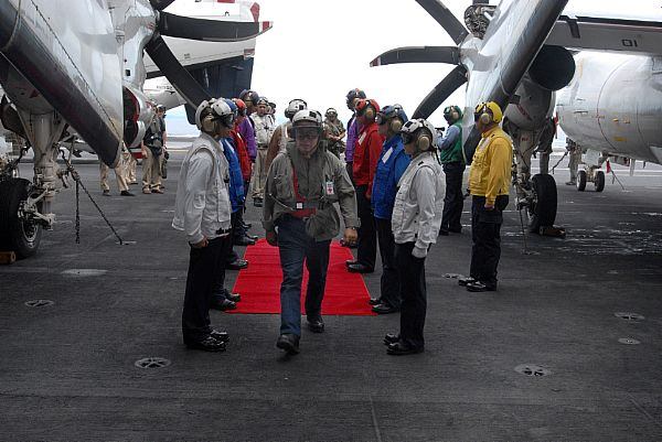 Republic of the Philippines Senator Dick Gordon is welcomed by rainbow sideboys, upon his first arrested landing aboard the Nimitz-class aircraft carrier USS Ronald Reagan (CVN 76). Senator Gordon flew aboard along with Armed Forces of the Philippines Chief of Staff, General Alexander B. Yano and U.S. Ambassador to the Republic of the Philippines, Kristie Kenney to discuss relief efforts.