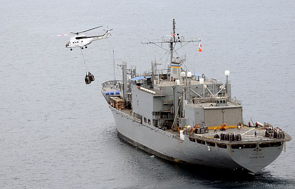 Super PUMA helicopters fly much needed bottled water to Kalibo, Republic of the Philippines from the deck of the Military Sealift Command combat stores ship USNS Niagara Falls (T-AFS 3) in the wake of Typhoon Fengshen