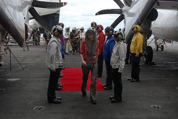 U.S. Ambassador to the Republic of the Philippines, Kristie Kenney is welcomed by rainbow sideboys, following her first arrested landing aboard USS Ronald Reagan (CVN 76). Ambassador Kenney flew aboard along with Armed Forces of the Philippines Chief of Staff, General Alexander B. Yano and Republic of the Philippines Senator Dick Gordon to discuss relief efforts.